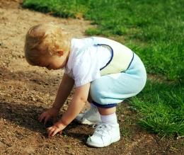 child testing soil 10
